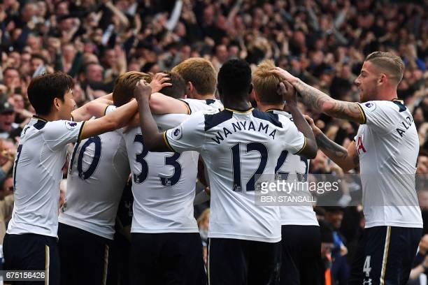 Tottenham Hotspur's English midfielder Dele Alli celebrates scoring the opening goal with teammates during the English Premier League football match...