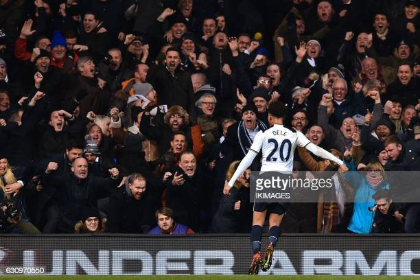 Tottenham Hotspur's English midfielder Dele Alli celebrates with fans after scoring the opening goal of the English Premier League football match...
