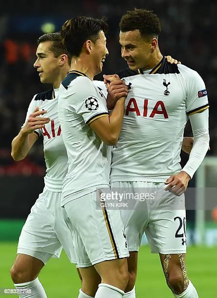 Tottenham Hotspur's English midfielder Dele Alli celebrates with Tottenham Hotspur's South Korean striker Son HeungMin and Tottenham Hotspur's...