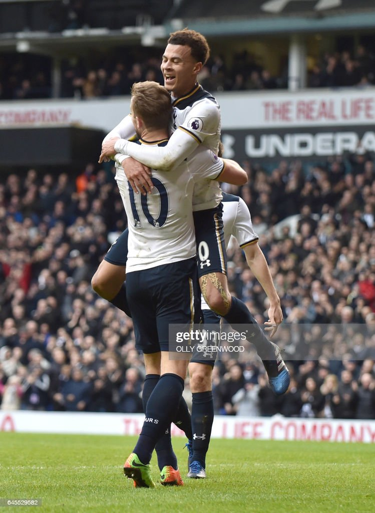 Tottenham Hotspur's English midfielder Dele Alli (R) celebrates with Tottenham Hotspur's English striker Harry Kane (2R) after scoring their fourth goal during the English Premier League football match between Tottenham Hotspur and Stoke City at White Hart Lane in London, on February 26, 2017. / AFP / OLLY GREENWOOD / RESTRICTED TO EDITORIAL USE. No use with unauthorized audio, video, data, fixture lists, club/league logos or 'live' services. Online in-match use limited to 75 images, no video emulation. No use in betting, games or single club/league/player publications. /