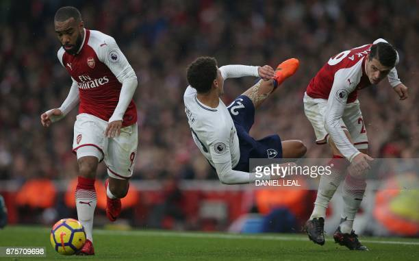 Tottenham Hotspur's English midfielder Dele Alli clashes with Arsenal's Swiss midfielder Granit Xhaka as Arsenal's French striker Alexandre Lacazette...