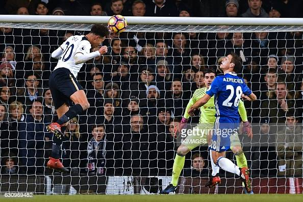 Tottenham Hotspur's English midfielder Dele Alli heads the opening goal past Chelsea's Belgian goalkeeper Thibaut Courtois during the English Premier...