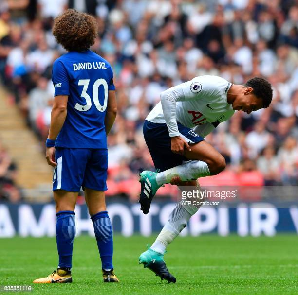 Tottenham Hotspur's English midfielder Dele Alli is caught in a challenge with Chelsea's Brazilian defender David Luiz during the English Premier...