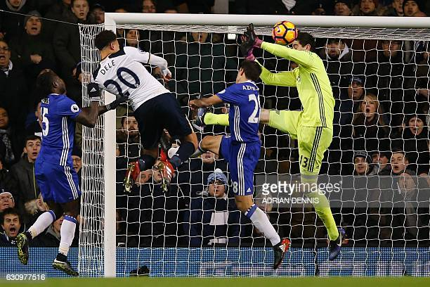 Tottenham Hotspur's English midfielder Dele Alli jumps to score his and Totenham's second goal with this header during the English Premier League...