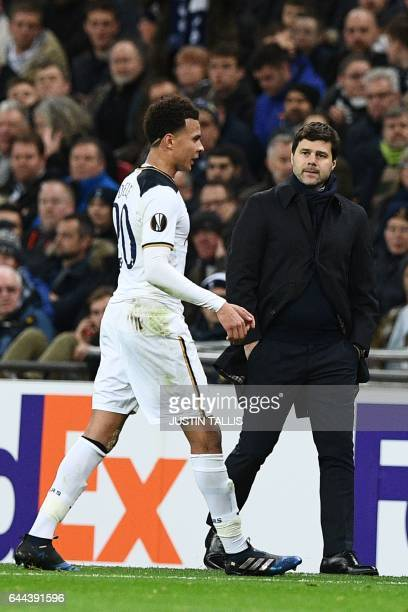 Tottenham Hotspur's English midfielder Dele Alli leaves the pitch after being sent off and walks past Tottenham Hotspur's Argentinian head coach...