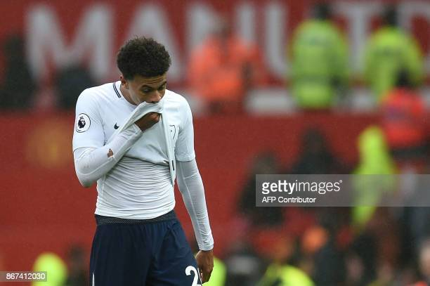 Tottenham Hotspur's English midfielder Dele Alli reacts to their defeat after the English Premier League football match between Manchester United and...