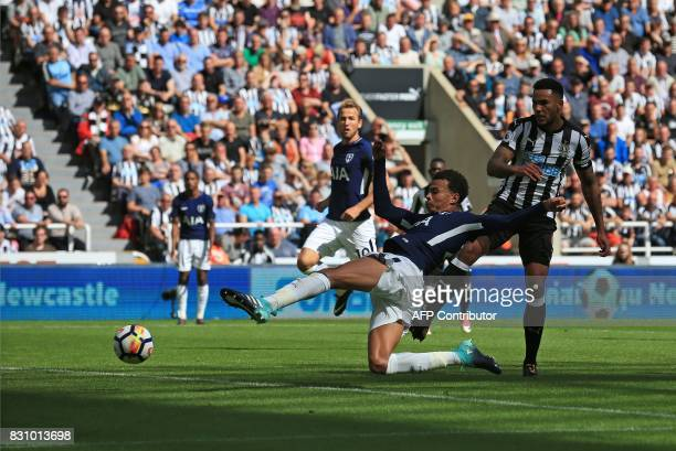 TOPSHOT Tottenham Hotspur's English midfielder Dele Alli scores his team's first and the opening goal during the English Premier League football...