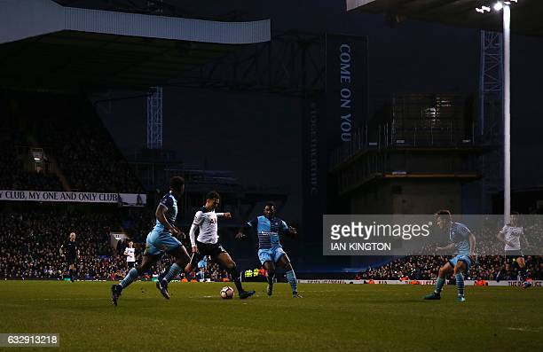 Tottenham Hotspur's English midfielder Dele Alli scores his team's third goal during the English FA Cup fourth round football match between Tottenham...