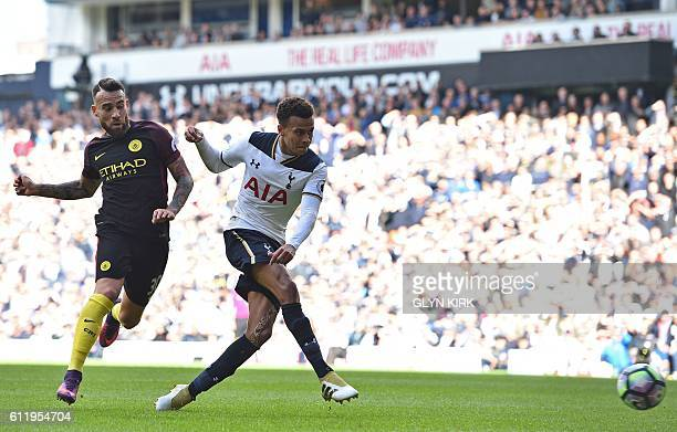 Tottenham Hotspur's English midfielder Dele Alli shoots to score their second goal under pressure from Manchester City's Argentinian defender Nicolas...