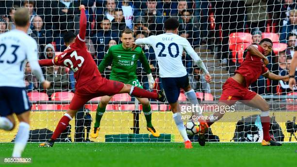 Tottenham Hotspur's English midfielder Dele Alli shoots to score their third goal past Liverpool's Belgian goalkeeper Simon Mignolet during the...