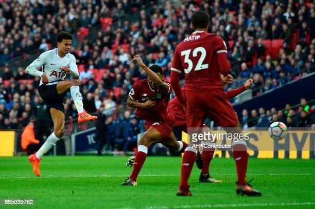 Tottenham Hotspur's English midfielder Dele Alli shoots to score their third goal during the English Premier League football match between Tottenham...