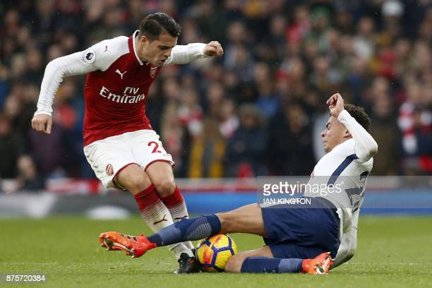 Tottenham Hotspur's English midfielder Dele Alli tackles Arsenal's Swiss midfielder Granit Xhaka during the English Premier League football match...