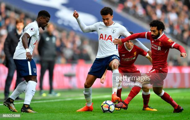 Tottenham Hotspur's English midfielder Dele Alli vies with Liverpool's Egyptian midfielder Mohamed Salah during the English Premier League football...