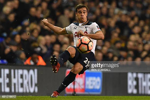 Tottenham Hotspur's English midfielder Harry Winks crosses the ball during the English FA Cup third round football match between Tottenham Hotspur...