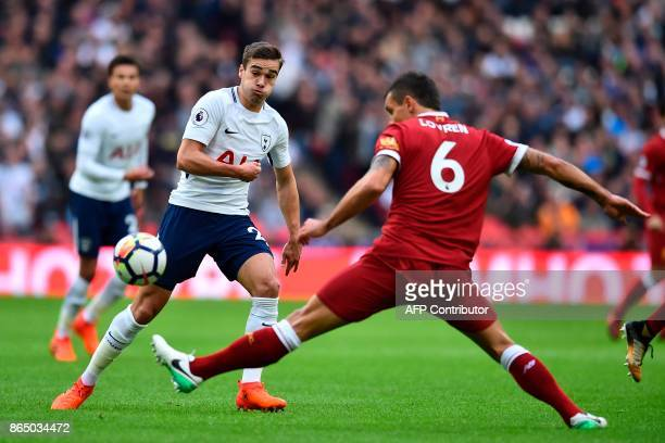 Tottenham Hotspur's English midfielder Harry Winks vies with Liverpool's Croatian defender Dejan Lovren during the English Premier League football...