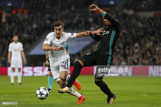 Tottenham Hotspur's English midfielder Harry Winks vies with Real Madrid's Brazilian midfielder Casemiro during the UEFA Champions League Group H...
