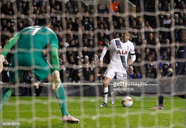 Tottenham Hotspur's English midfielder Tom Carroll dribbles on his way to score during the UEFA Europa League group J football match between...