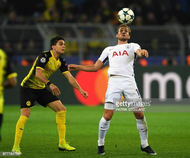 Tottenham Hotspur's English striker Harry Kane and Dortmund's Spanish defender Marc Bartra vie for the ball during the UEFA Champions League Group H...