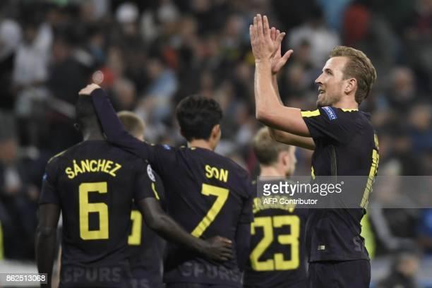 Tottenham Hotspur's English striker Harry Kane applauds after the UEFA Champions League group H football match Real Madrid CF vs Tottenham Hotspur FC...