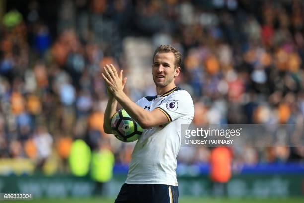 Tottenham Hotspur's English striker Harry Kane applauds the fans following the English Premier League football match between Hull City and Tottenham...