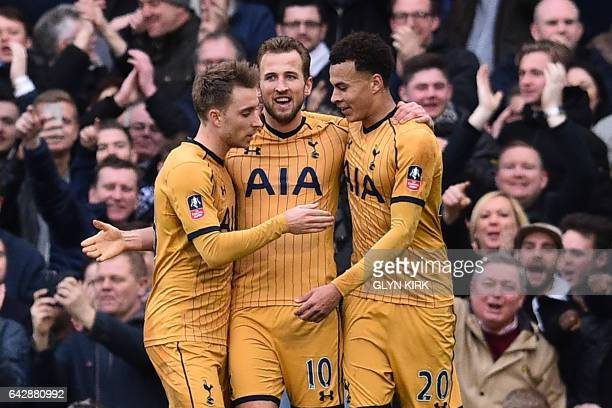 Tottenham Hotspur's English striker Harry Kane celebrates after scoring a hattrick with Tottenham Hotspur's Danish midfielder Christian Eriksen and...