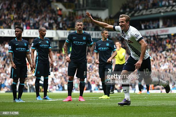 Tottenham Hotspur's English striker Harry Kane celebrates after scoring their third goal during the English Premier League football match between...