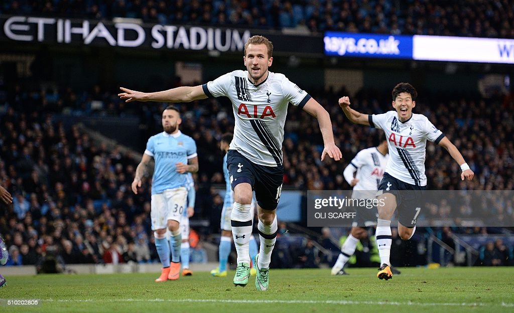 Tottenham Hotspur's English striker Harry Kane (C) celebrates scoring his team's first goal during the English Premier League football match between Manchester City and Tottenham Hotspur at the Etihad Stadium in Manchester, north west England, on February 14, 2016. / AFP / OLI SCARFF / RESTRICTED TO EDITORIAL USE. No use with unauthorized audio, video, data, fixture lists, club/league logos or 'live' services. Online in-match use limited to 75 images, no video emulation. No use in betting, games or single club/league/player publications. /