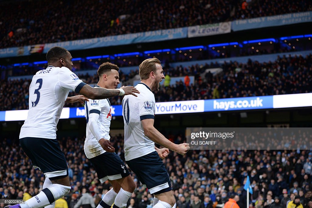 Tottenham Hotspur's English striker Harry Kane (R) celebrates scoring his team's first goal during the English Premier League football match between Manchester City and Tottenham Hotspur at the Etihad Stadium in Manchester, north west England, on February 14, 2016. / AFP / OLI SCARFF / RESTRICTED TO EDITORIAL USE. No use with unauthorized audio, video, data, fixture lists, club/league logos or 'live' services. Online in-match use limited to 75 images, no video emulation. No use in betting, games or single club/league/player publications. /