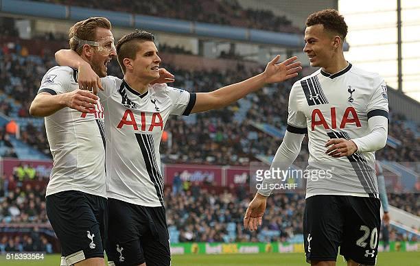 Tottenham Hotspur's English striker Harry Kane celebrates scoring his team's second goal with Tottenham Hotspur's Argentinian midfielder Erik Lamela...