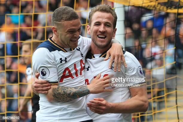 Tottenham Hotspur's English striker Harry Kane celebrates scoring his team's second goal with Tottenham Hotspur's English defender Kieran Trippier...