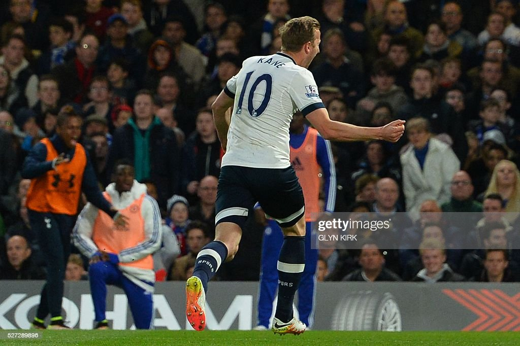 Tottenham Hotspur's English striker Harry Kane celebrates scoring the opening goal during the English Premier League football match between Chelsea and Tottenham Hotspur at Stamford Bridge in London on May 2, 2016. / AFP / GLYN KIRK / RESTRICTED TO EDITORIAL USE. No use with unauthorized audio, video, data, fixture lists, club/league logos or 'live' services. Online in-match use limited to 75 images, no video emulation. No use in betting, games or single club/league/player publications. /