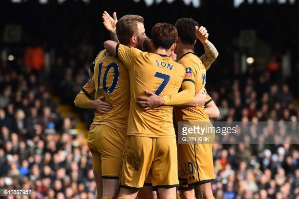 Tottenham Hotspur's English striker Harry Kane celebrates with teammates after scoring during the English FA Cup fifth round football match between...
