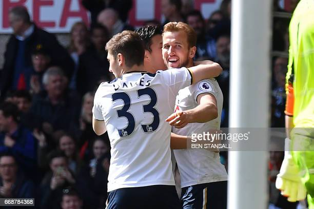 Tottenham Hotspur's English striker Harry Kane celebrates with teammates after scoring their third goal during the English Premier League football...