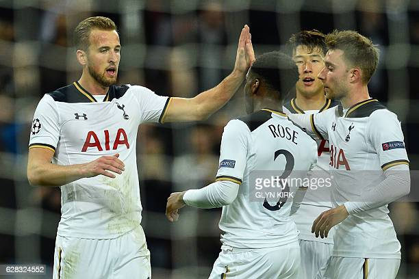 Tottenham Hotspur's English striker Harry Kane celebrates with Tottenham Hotspur's English defender Danny Rose Tottenham Hotspur's South Korean...