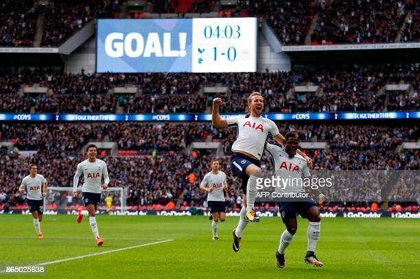 Tottenham Hotspur's English striker Harry Kane celebrates with Tottenham Hotspur's Ivorian defender Serge Aurier after scoring the opening goal of...