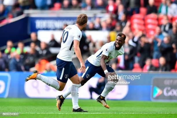 Tottenham Hotspur's English striker Harry Kane celebrates with Tottenham Hotspur's Ivorian defender Serge Aurier after scoring the opening goal of...