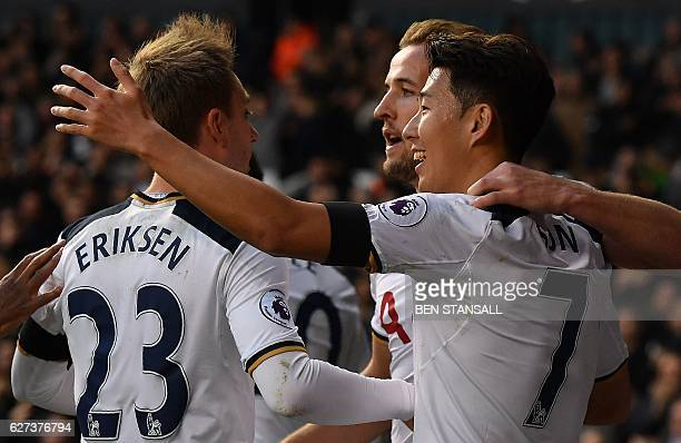Tottenham Hotspur's English striker Harry Kane celebrates with Tottenham Hotspur's South Korean striker Son HeungMin and Tottenham Hotspur's Danish...