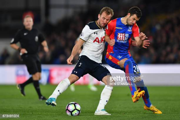 Tottenham Hotspur's English striker Harry Kane clashes with Crystal Palace's Serbian midfielder Luka Milivojevic during the English Premier League...