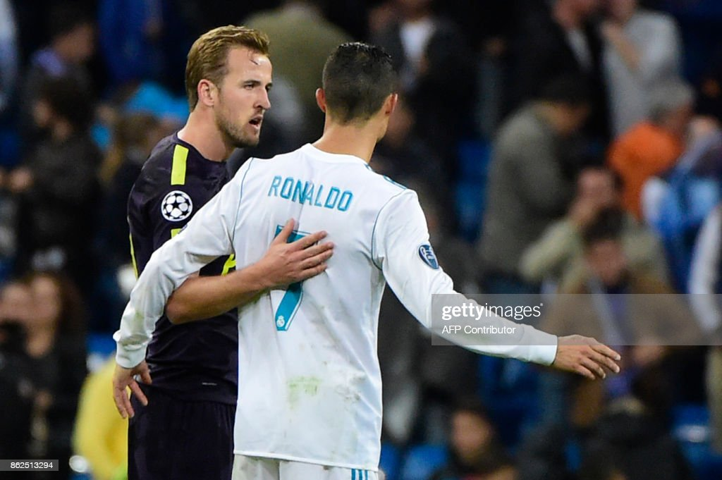 TOPSHOT - Tottenham Hotspur's English striker Harry Kane (L) greets Real Madrid's Portuguese forward Cristiano Ronaldo after the UEFA Champions League group H football match Real Madrid CF vs Tottenham Hotspur FC at the Santiago Bernabeu stadium in Madrid on October 17, 2017. /