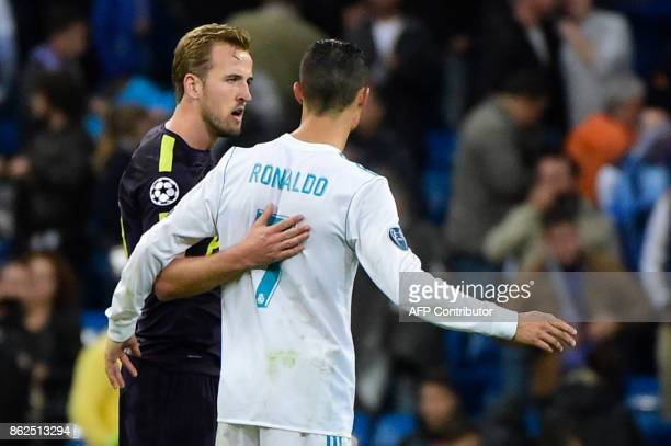 TOPSHOT Tottenham Hotspur's English striker Harry Kane greets Real Madrid's Portuguese forward Cristiano Ronaldo after the UEFA Champions League...