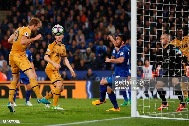 Tottenham Hotspur's English striker Harry Kane heads home their third goal during the English Premier League football match between Leicester City...