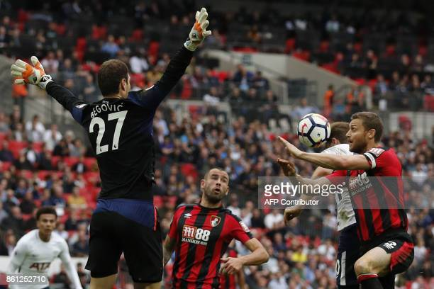 Tottenham Hotspur's English striker Harry Kane heads the ball to goal but disallowed during the English Premier League football match between...