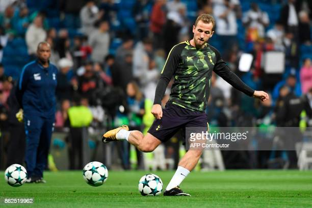 Tottenham Hotspur's English striker Harry Kane kicks the ball during a warm up before the UEFA Champions League group H football match Real Madrid CF...