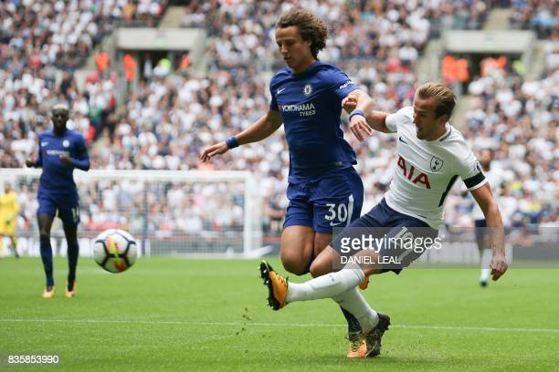 Tottenham Hotspur's English striker Harry Kane plays the ball past Chelsea's Brazilian defender David Luiz during the English Premier League football...