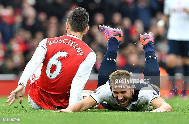 TOPSHOT Tottenham Hotspur's English striker Harry Kane reacts after being tackled by Arsenal's French defender Laurent Koscielny during the English...