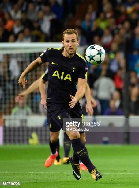 Tottenham Hotspur's English striker Harry Kane runs with the ball during the UEFA Champions League group H football match Real Madrid CF vs Tottenham...