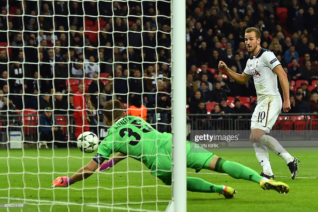 Tottenham Hotspur's English striker Harry Kane (R) scores past CSKA Moscow's Russian goalkeeper Igor Akinfeev as Spurs take a 2-1 lead during the UEFA Champions League group E football match between Tottenham Hotspur and CSKA Moscow at Wembley Stadium in north London on December 7, 2016. / AFP / Glyn KIRK