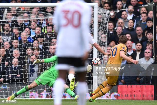 Tottenham Hotspur's English striker Harry Kane scores their third goal during the English FA Cup fifth round football match between Fulham and...