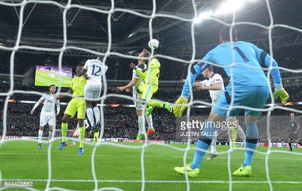 TOPSHOT Tottenham Hotspur's English striker Harry Kane sees his defensive header go into his own goal to score an own goal to level the scores 11...