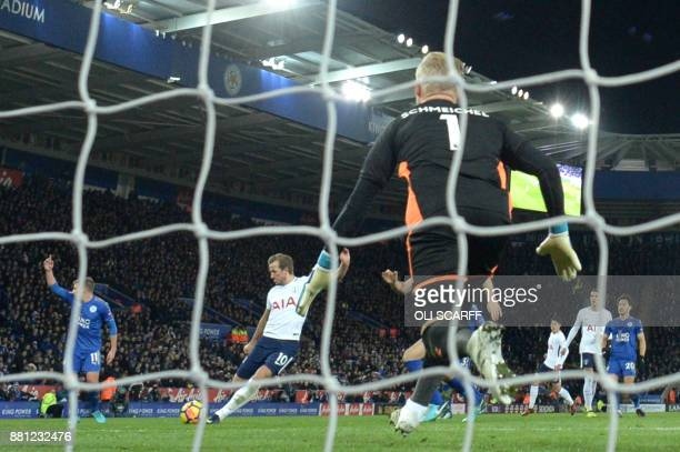 Tottenham Hotspur's English striker Harry Kane shoots and scores past Leicester City's Danish goalkeeper Kasper Schmeichel during the English Premier...
